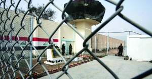 In this Feb. 21, 2009 file photo, guards stand at the entrance of Abu Ghraib prison on the outskirts of Baghdad, Iraq. (AP Photo/Karim Kadim, File)