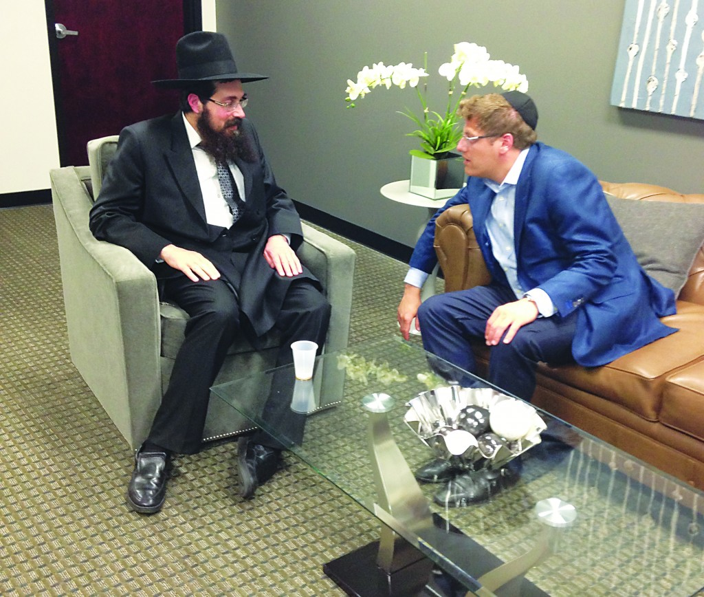 """Harav Lazer Yudel Finkel, Rosh Yeshivas Mir Yerushalayim, visited at the office of Boruch Jeremias, a Mirrer talmid and supporter, during a brief trip to Lakewood on Wednesday night. The Rosh Yeshivah was in Deal, N.J., for fundraising but stopped in Lakewood for a few hours where he signed """"partnership contracts"""" with several supporters. The contracts, similar to those his father, Harav Nosson Tzvi, zt""""l, would sign, would make the yeshivah a partner in the business. The Rosh Yeshivah returned to Eretz Yisrael later that night."""