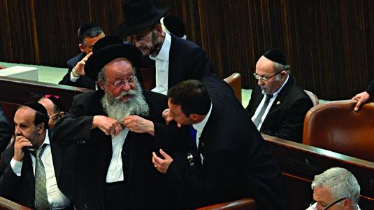 MK Menachem Eliezer Moses (UTJ) tearing kriah.