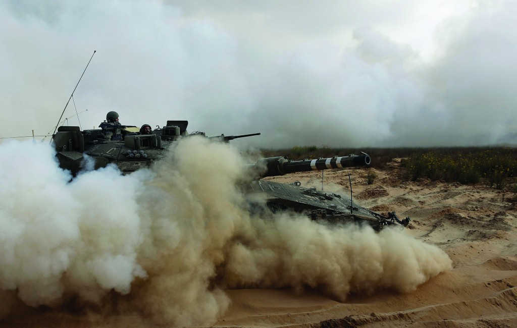 An Israeli army tank maneuver near the Israel–Gaza border in southern Israel, Thursday, July 11. Israeli officials say they are closely watching the events unfolding in neighboring Egypt, fearing that Islamic militants will try to exploit the unrest. But the military says it has not yet taken any special action in the south and continues to conduct only routine activities along the Gaza and Egyptian fronts.(AP Photo/Tsafrir Abayov)