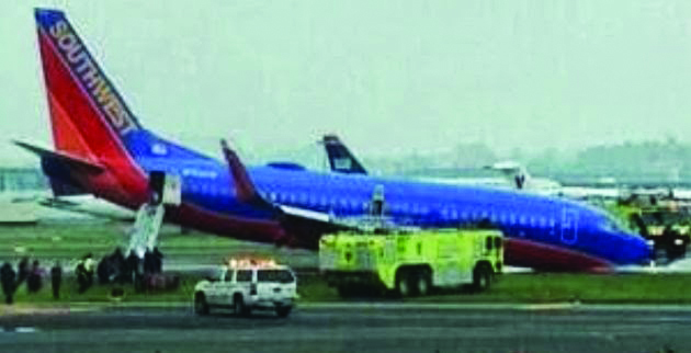 A Southwest Airlines plane with the nose gear collapsed during landing at LaGuardia Airport Monday.