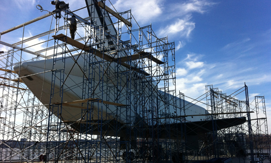 The space shuttle Enterprise scaffolded for repairs, completed Wednesday. (Intrepid Sea, Air & Space Museum)