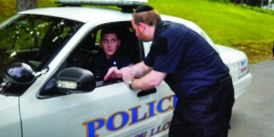 Moshe Henig, Camp Karlin Stolin's paramedic, talks on Sunday with Lloyd Police officer John Zani. (News Breakers)