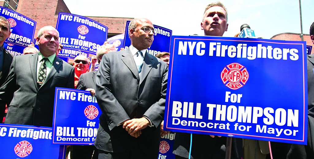 Bill Thompson, center, reacts after receiving the endorsement of the Uniformed Firefighters Association Tuesday. A recent poll has Thompson in a virtual three-way tie for first with Council Speaker Christine Quinn and former Rep. Anthony Weiner atop the Democratic field. (AP Photo/Bebeto Matthews)