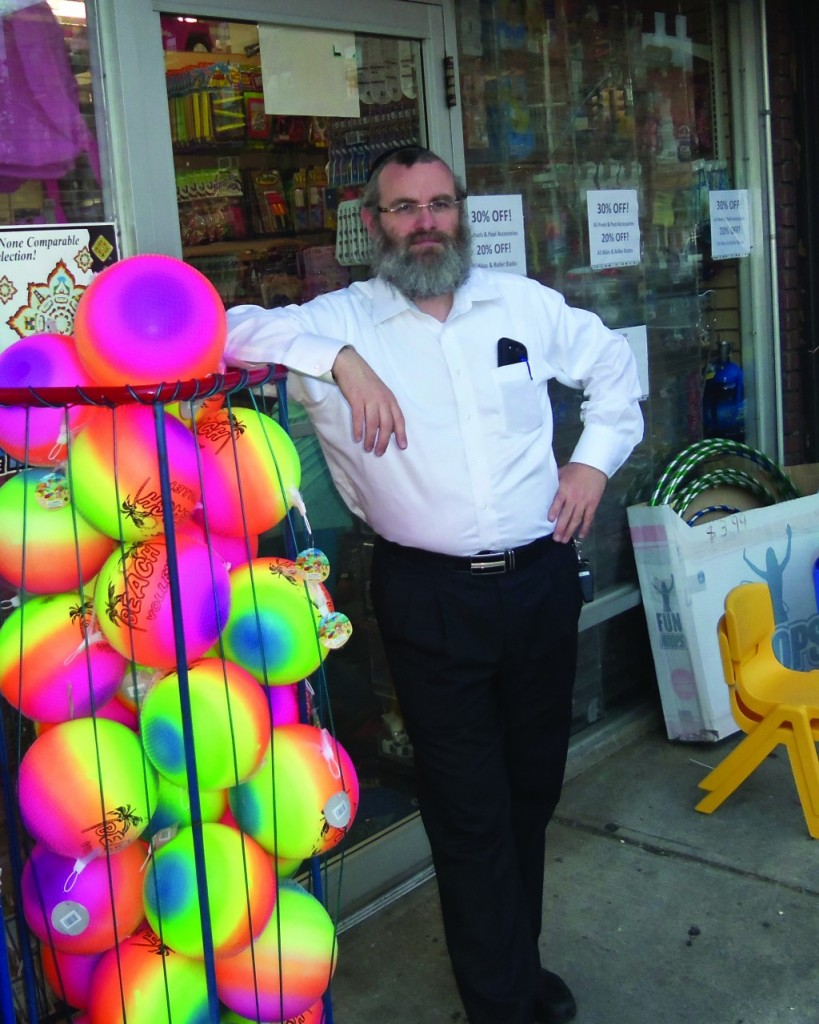 Yonesen Schwartz, owner of Toys 2 Discover in Boro Park, in front of his store.