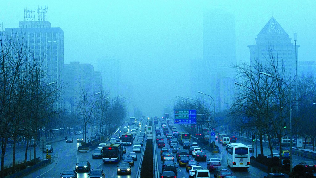 Vehicles crawl along a major road in Beijing, China, Thursday, Jan. 31, 2013. Endless lines of slow-moving cars emerge like apparitions and disappear into the gloom of the thick smog that has shrouded Beijing for weeks and reduced its skyline to blurry gray shapes. (AP Photo/Ng Han Guan)