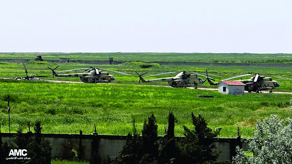 Syrian military helicopters at Mannagh air base in Aleppo province, Syria. (AP Photo/Aleppo Media Center AMC, File)