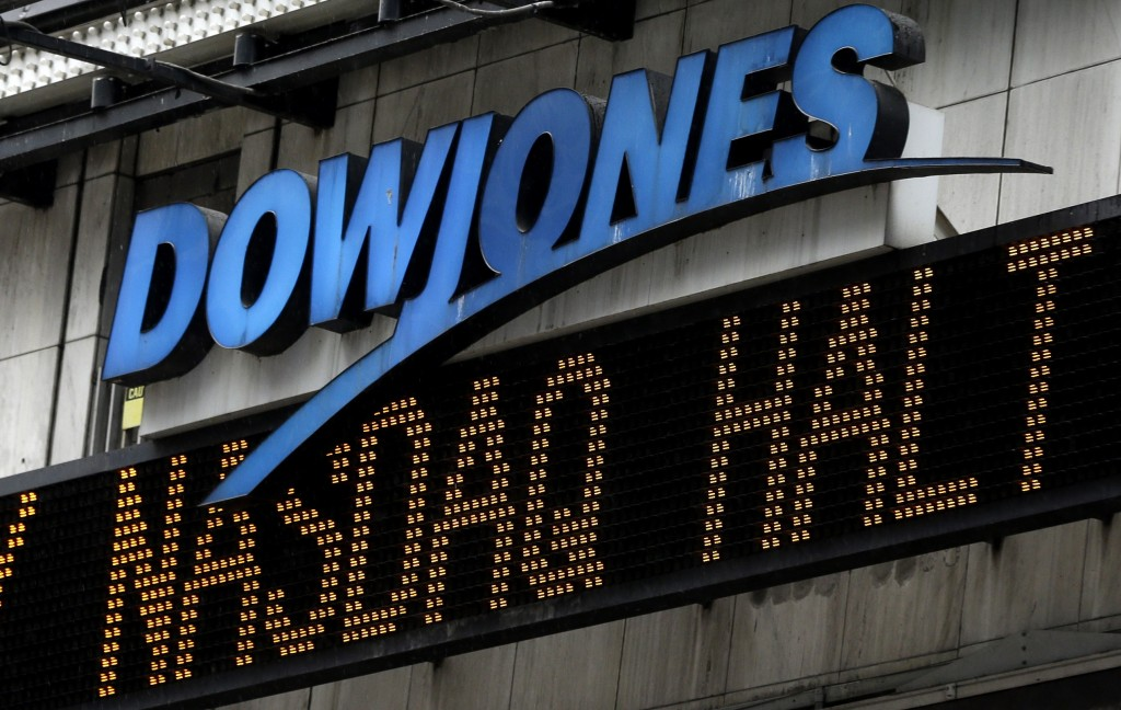 An electronic display in Times Square displays news about the Nasdaq in New York, Thursday, Aug. 22, 2013. Nasdaq halted trading Thursday because of a technical problem, the latest glitch to affect the stock market. (AP Photo/Seth Wenig)