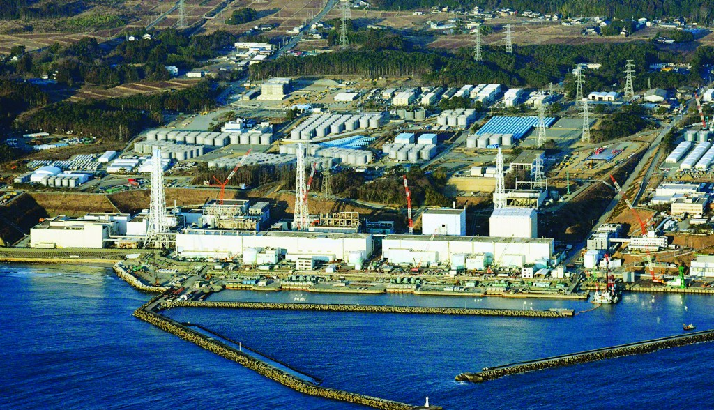 An aerial view shows Tokyo Electric Power Co.'s (TEPCO) crippled Fukushima Daiichi nuclear power plant in Fukushima. An earthquake and tsunami caused three reactor meltdowns in March 2011, causing contaminated leaks. The Japanese government said this month it will step up its involvement in the cleanup, following Tepco's admission, after months of denial, that leaked contaminated water had previously reached the ocean. (REUTERS/Kyodo/Files)