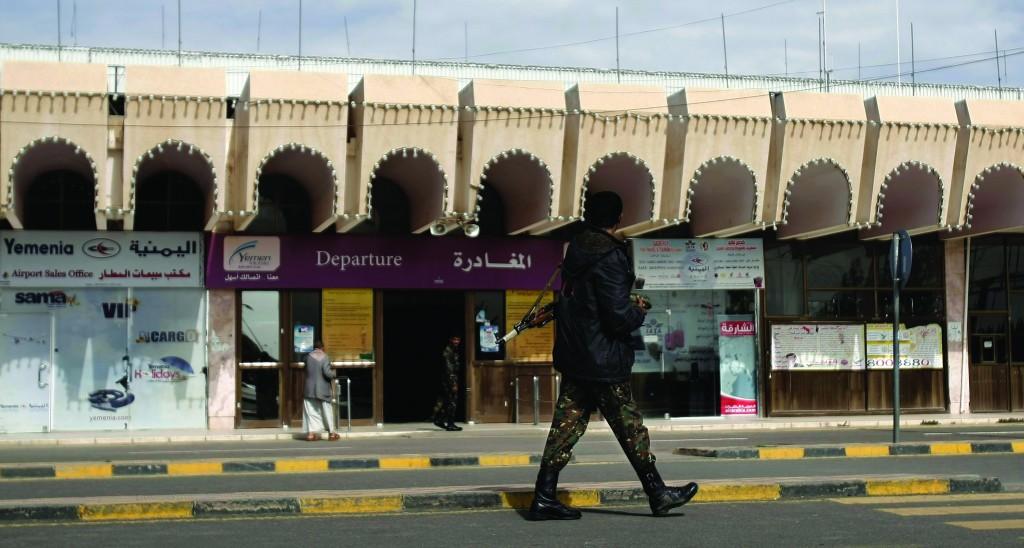 A policeman walks as he secures the Sanaa International Airport, in Yemen, Wednesday. (AP Photo/Hani Mohammed)