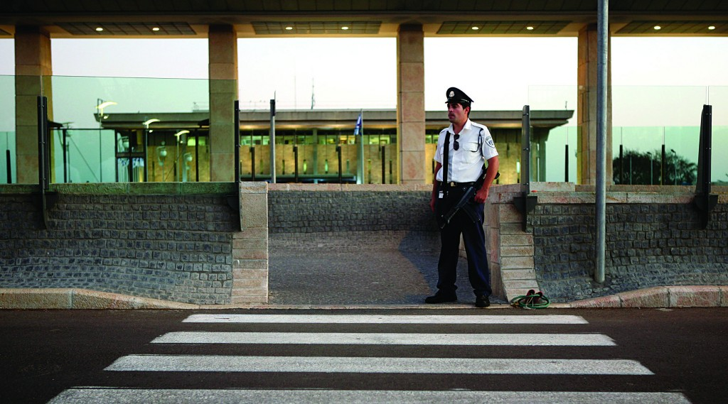 A security guard at the entrance to the Knesset. (Matanya Tausig/Flash90)