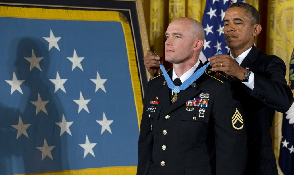 President Barack Obama awards US Army Staff Sgt. Ty M. Carter the Medal of Honor for conspicuous gallantry, Monday, during a ceremony in the East Room of the White House in Washington. (AP Photo/Jacquelyn Martin)