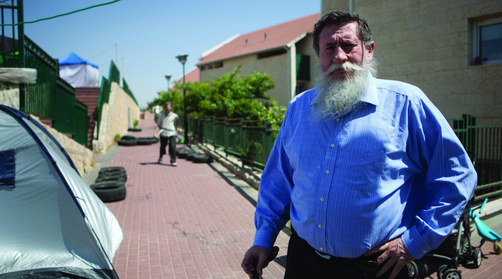 Former chairman of the National Union party Yaakov Katz posing for a photo in Beit El. (Photo by Uri Lenz/FLASH90)