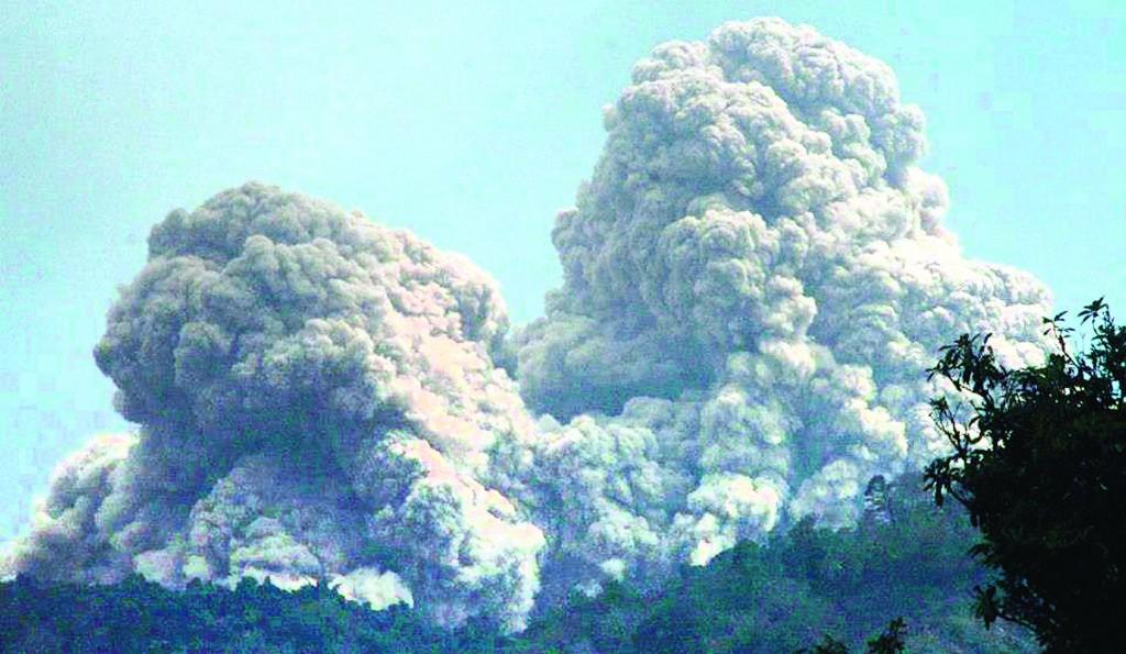 Mount Rokatenda spews volcanic material as it erupts on Palue island, Indonesia, Sunday. (AP Photo)