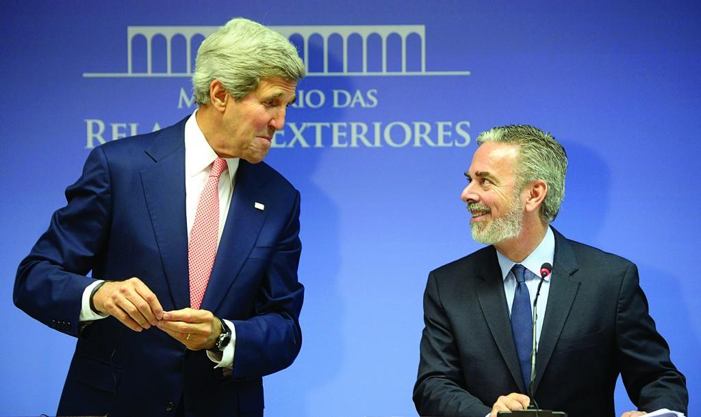 Secretary of State John Kerry (L), and Brazil's Foreign Minister Antonio de Aguiar Patriota give a press conference at Itamaraty palace in Brasilia, Brazil, Tuesday. (AP Photo/Evaristo Sa, Pool)