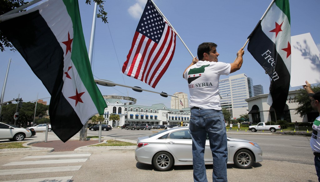 People demonstrate for United States involvement in the conflict in Syria on Saturday, in Houston. (AP Photo/Eric Kayne)