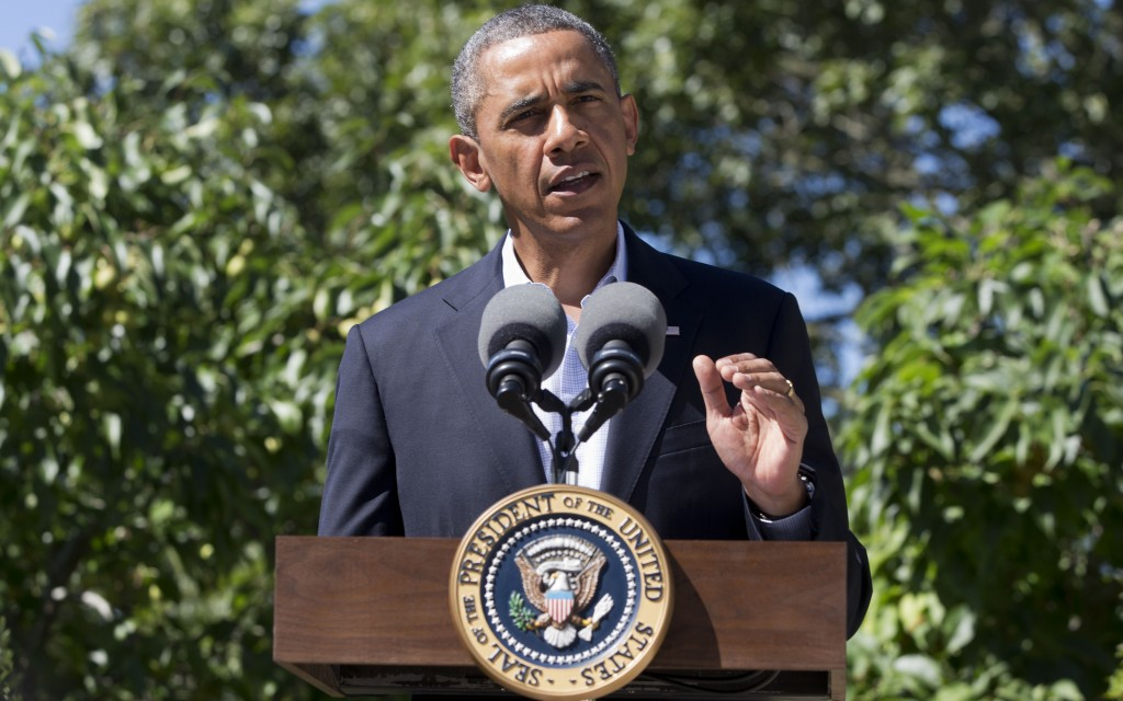 President Barack Obama makes a statement to the media regarding events in Egypt, from his rental vacation home in Chilmark Mass., on the island of Martha's Vineyard. (AP Photo/Jacquelyn Martin)