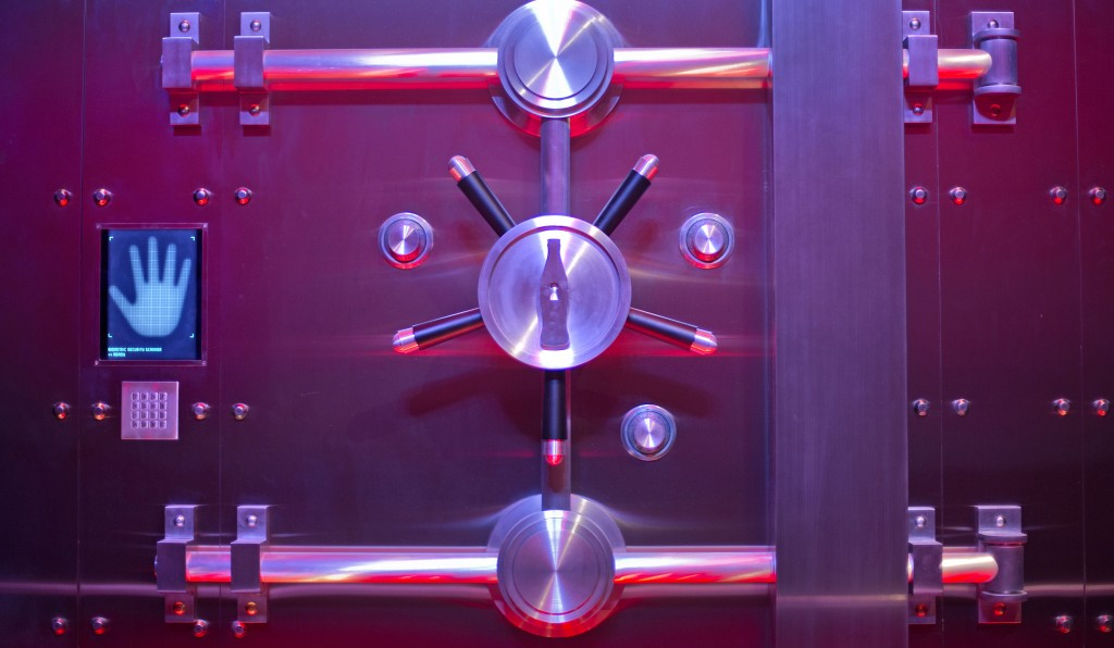 """In this Friday, Aug. 9, 2013 photo, the vault containing the """"secret recipe"""" for Coca-Cola stands on display at the World of Coca-Cola museum in Atlanta. (AP Photo/David Goldman)"""