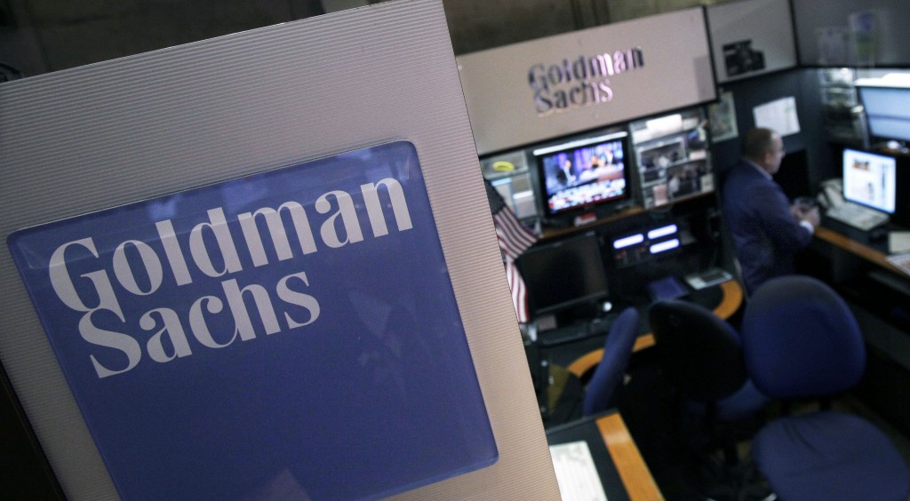 A trader works in the Goldman Sachs booth on the floor of the New York Stock Exchange. (AP Photo/Richard Drew, File)