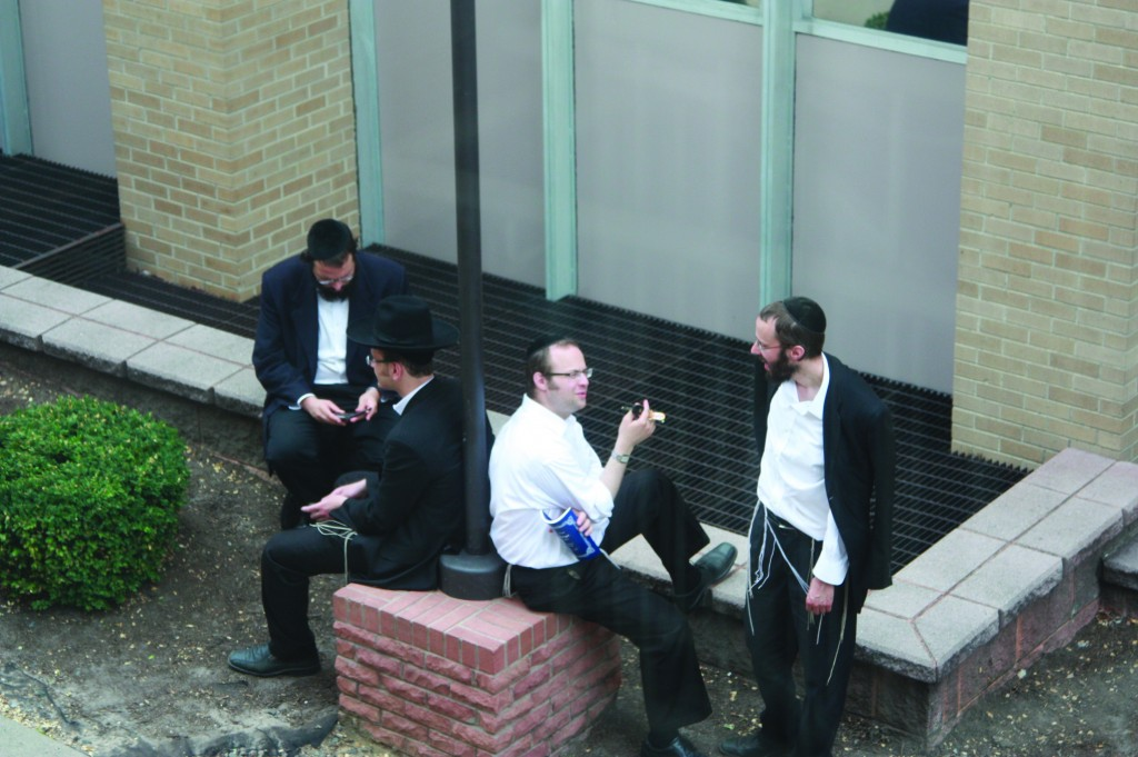 """A """"chavrusa tumult"""" at Lakewood's Bais Medrash Govoha Wednesday, as the Elul zman gets underway. (Kuvien Images)"""