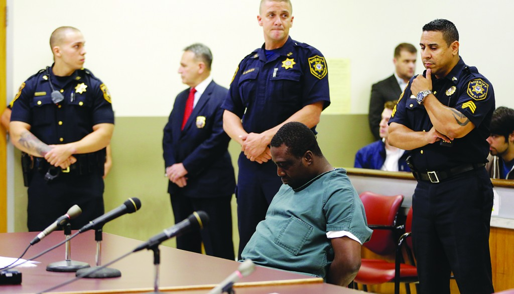 Idowu Daramola sits in court as he is charged with reckless driving that caused the killing of an infant. (AP Photo/Julio Cortez)
