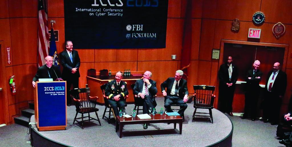 Seated L-R: The NSA's Keith Alexander, CIA's John Brennan and FBI's Robert Mueller watch as President of Fordham University Joseph Michael McShane addresses the International Conference on Cybersecurity Thursday. (AP Photo/Bebeto Matthews)