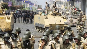 Riot police and army personnel take them up positions during clashes with members of the Muslim Brotherhood and supporters of ousted Egyptian President Mohamed Mursi around the area of Rabaa Adawiya square, where they are camping, in Cairo Wednesday. (REUTERS/Asmaa Waguih)