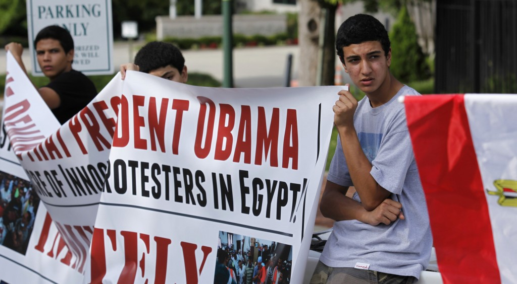 Activists from the Egyptian-Americans for Democracy and Human Rights organization protest outside the Egyptian embassy in Washington. (REUTERS/Yuri Gripas)