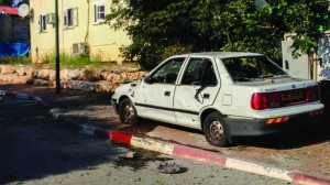 A car damaged by Katyusha rocket fire from Lebanon in Kibbutz Gesher HaZiv, near Nahariya, on Thursday. (Kobi Snir/FLASH90)