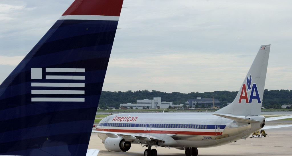 An American Airlines plane and a US Airways plane are parked at Washington's Ronald Reagan National Airport, Tuesday. (AP Photo/Susan Walsh)