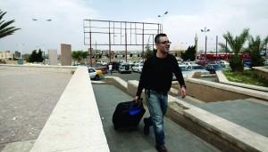 A traveler walks to the departure lounge at Sanaa International Airport, Yemen, Tuesday. (AP Photo/Hani Mohammed)