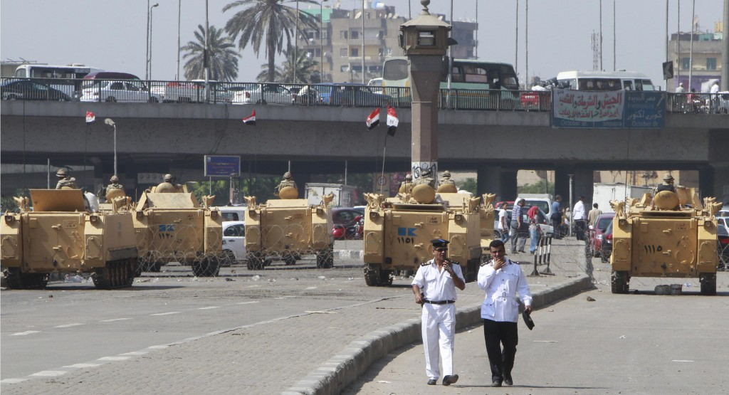 Egyptian army soldiers guard with armored personnel carriers (APC) near Tahrir Square in Cairo Monday. (REUTERS/Mohamed Abd El Ghany)