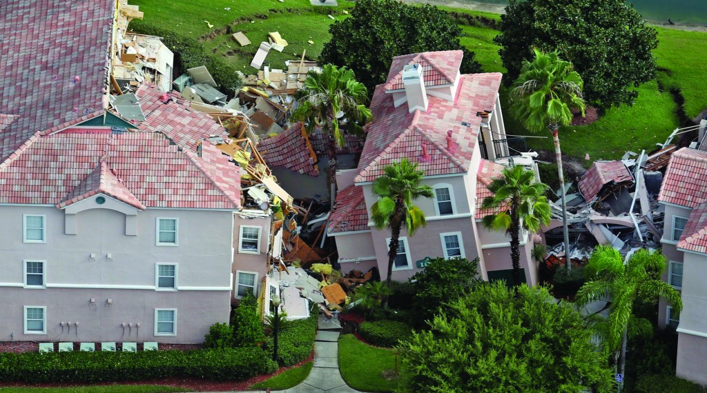 Guests had only 10 to 15 minutes to escape the collapsing buildings at the Summer Bay Resort on U.S. Highway 192 in the Four Corners area, Monday, where a large sinkhole — about 60 feet in diameter and 15 feet deep — opened in the earth late Sunday. (Red Huber/Orlando Sentinel/MCT)