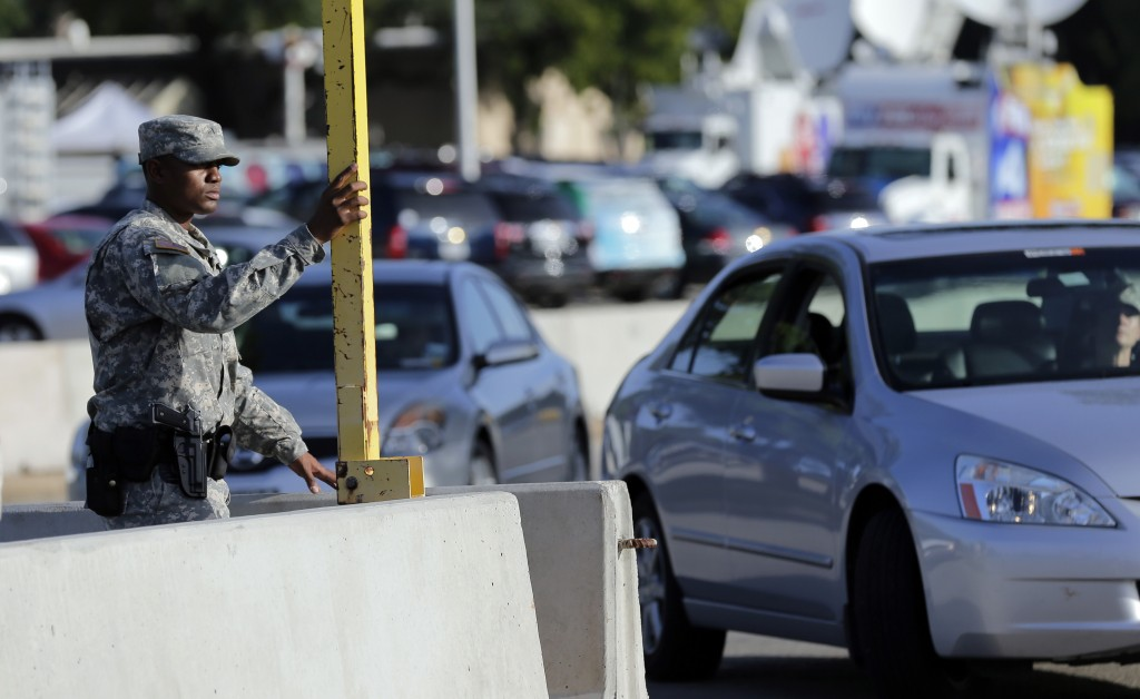 A soldier raises the gate at a security point to enter the Lawrence William Judicial Center as the sentencing phase for Maj. Nidal Hasan continues, Wednesday. (AP Photo/Eric Gay)