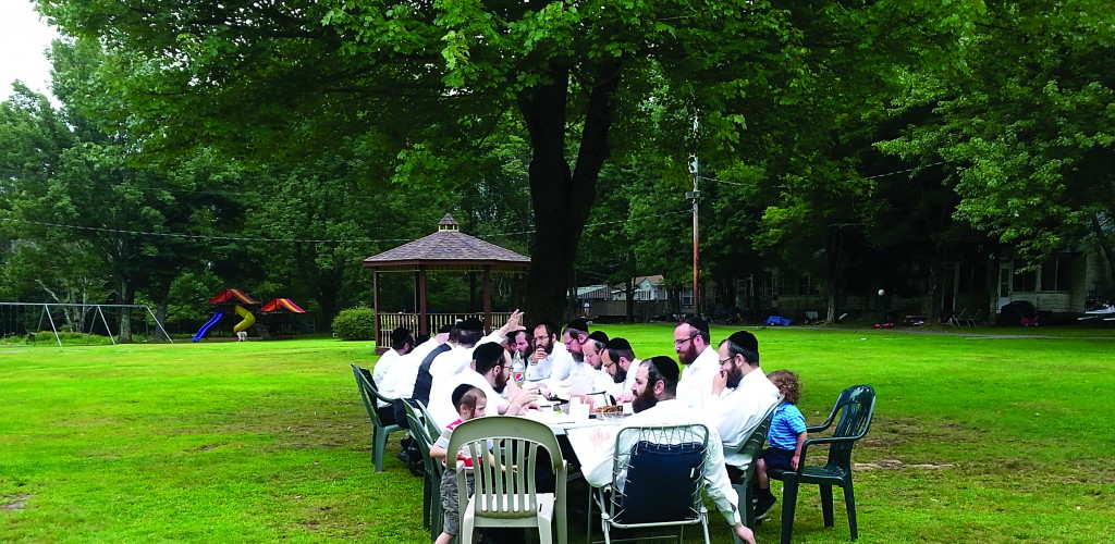 Harav Gavriel Goldberger giving his weekly Sunday shiur in Garden Cottages bungalows, in Monticello, N.Y.