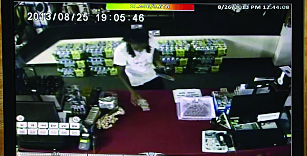 A man is seen on surveillance camera paying for merchandise he bought Sunday evening at Buddy's Small Lots even though no clerk was around.