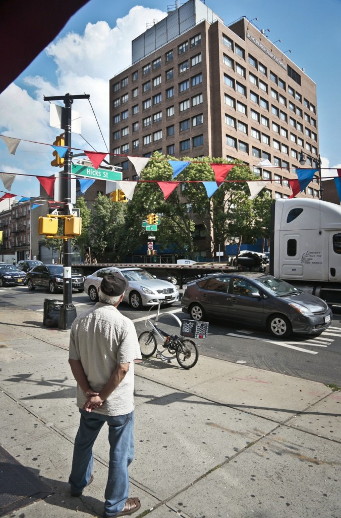 A pedestrian looks at the Long Island College Hospital Tuesday in Brooklyn.(AP Photo/Bebeto Matthews)