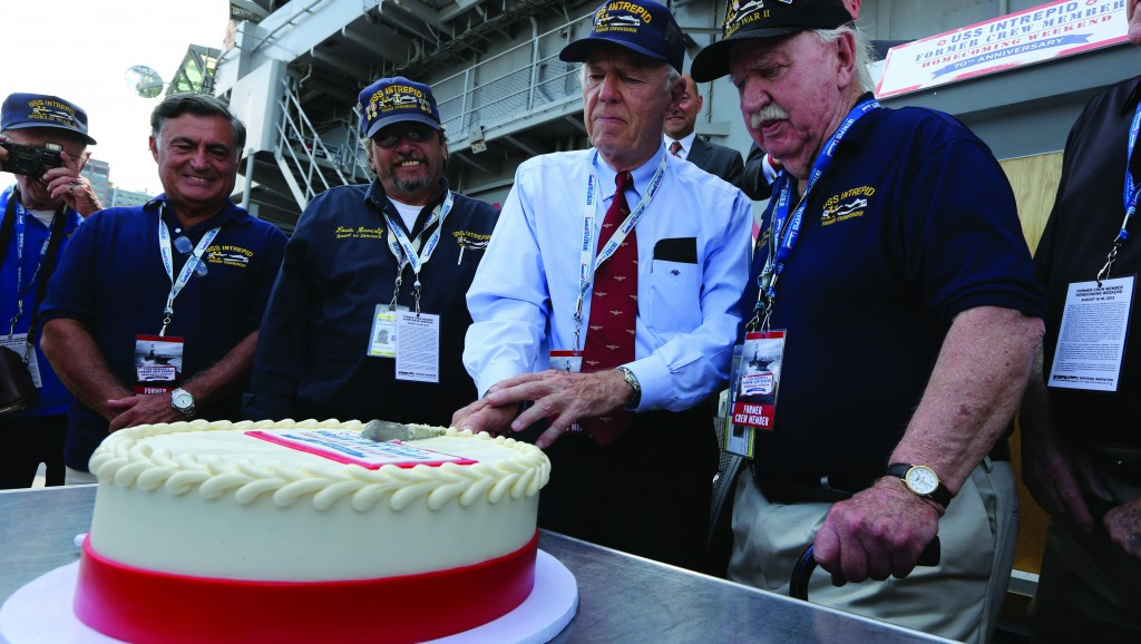 Veterans who served on the Intrepid cut a cake during a ceremony at the Intrepid Sea, Air & Space Museum marking the 70th anniversary of the ship's commissioning, Friday. (AP Photo/Mary Altaffer)