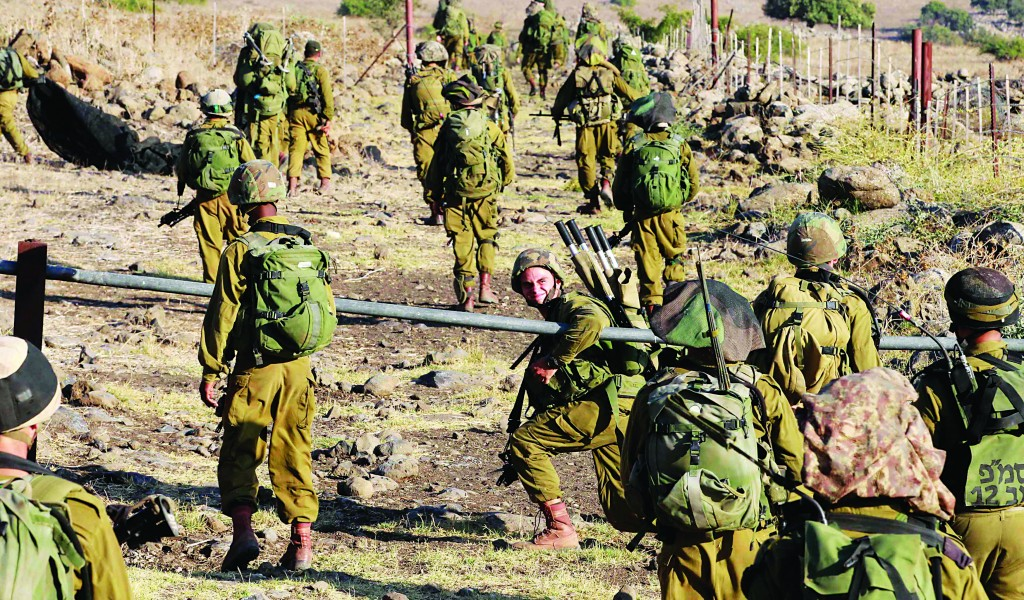 Israeli soldiers conduct a drill on the Golan Heights on Wednesday. (REUTERS/Baz Ratner)