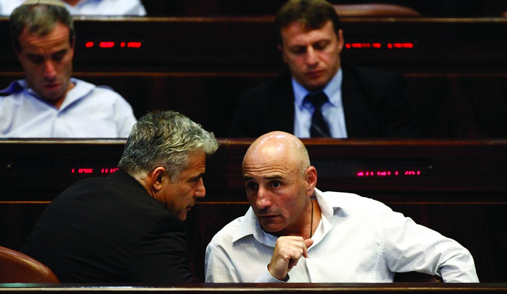 """Israeli Finance Minister Yair Lapid (L) and Yesh Atid MK Ofer Shelah don't see eye to eye on the """"final status"""" of Yerushalayim. (FLASH90)"""