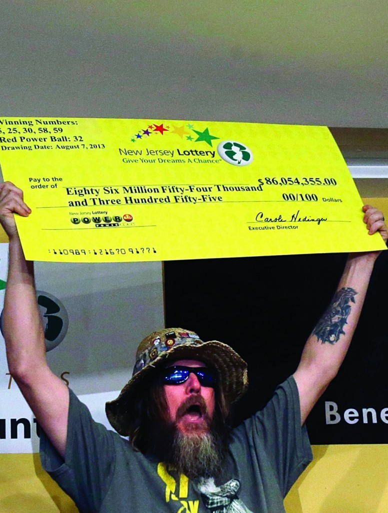 Winner William Seeley on Tuesday shouts as he holds up his check. (AP Photo/Mel Evans)