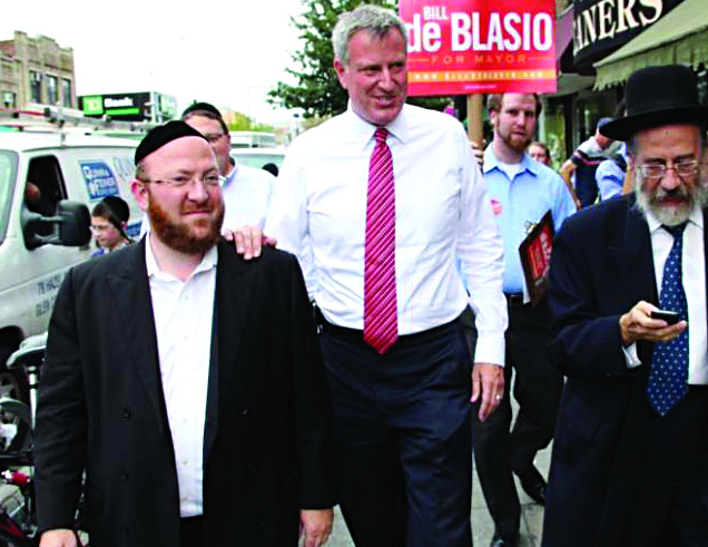 Democratic mayoral candidate Bill de Blasio (C) walks down 13th Avenue Tuesday, with Ari Noe (L) and Yitzchok Fleischer (R), two longtime supporters.