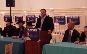 Shea Rubinstein speaking at an event in Boro Park Tuesday night for Orthodox Jewish supporters of Bill Thompson (right).