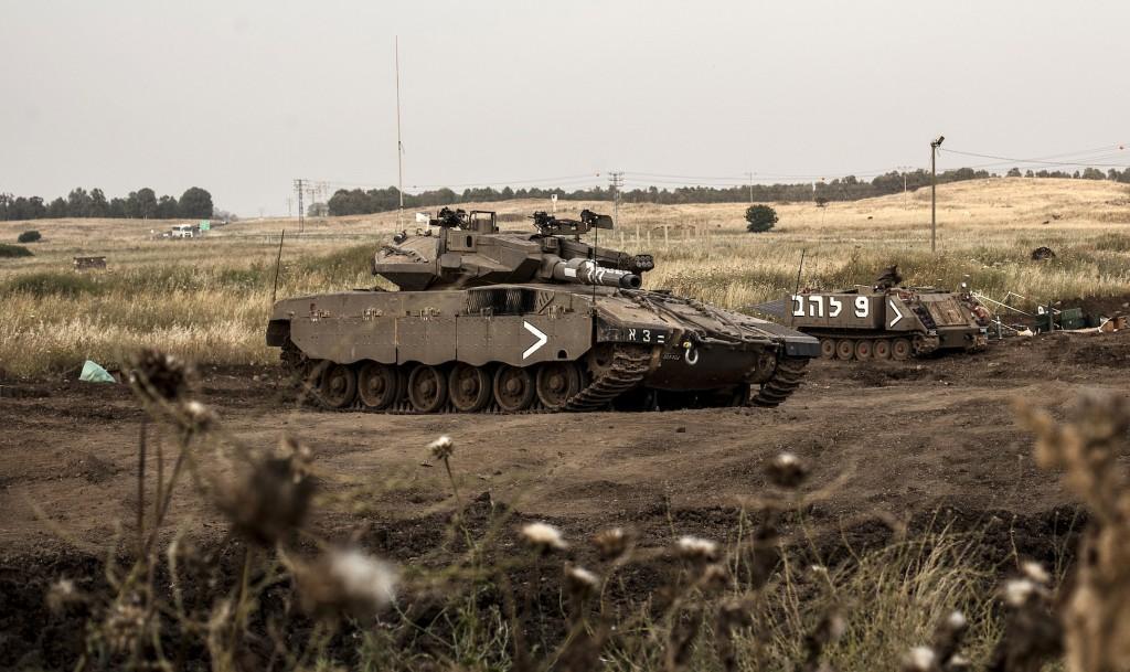 Israeli Merkava tanks in action on the Golan Heights recently. (Neal Badache/FLASH90)