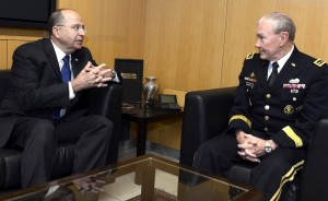 Israel's Defense Minister Moshe Yaalon with U.S. Chairman of the Joint Chiefs of Staff Gen. Martin Dempsey at the Defense Ministry in Tel Aviv. Yaalon announced resumption of Merkava tank production on Wednesday. (Matty Stern/US Embassy/Flash90)