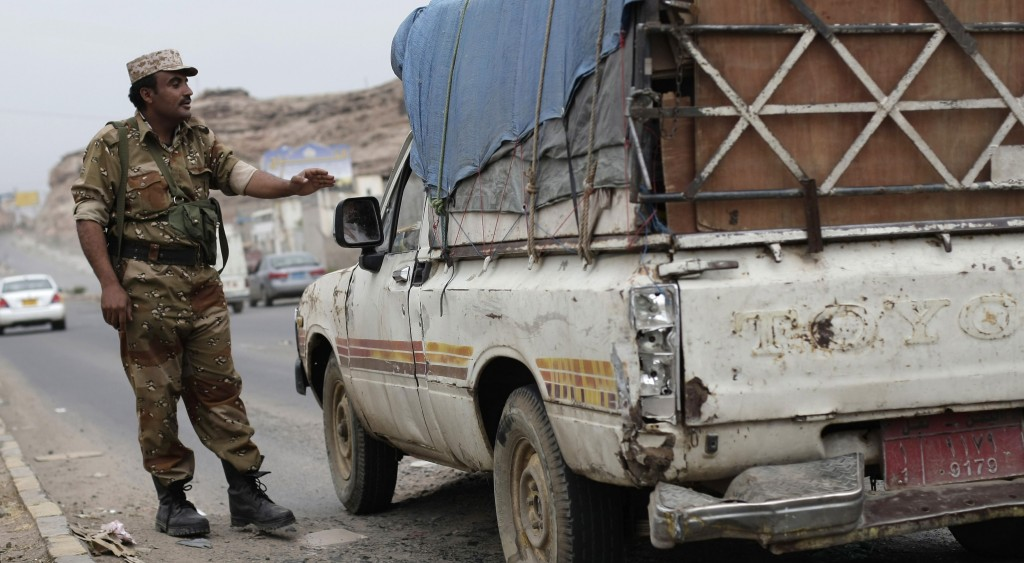 A Yemeni soldier stops a car at a checkpoint in a street leading to the U.S. embassy in Sanaa, Yemen. (AP Photo/Hani Mohammed)