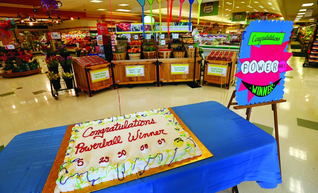 A cake celebrating a Powerball winner sits on a table near the entrance of Stop & Shop in South Brunswick, Thursday. One of the three winning Powerball tickets was sold at this store; the other two were sold in southern New Jersey and Minnesota. (AP Photo/Rich Schultz)