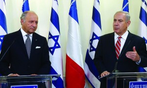 Israeli Prime Minister Binyamin Netanyahu (R) and Foreign Minister of France Laurent Fabius in a joint press conference on Sunday. (Marc Israel Sellem/Pool/Flash90)