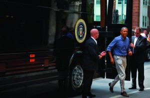 President Obama gets off his bus during a stop in Rochester, NY, Thursday. (AP Photo)