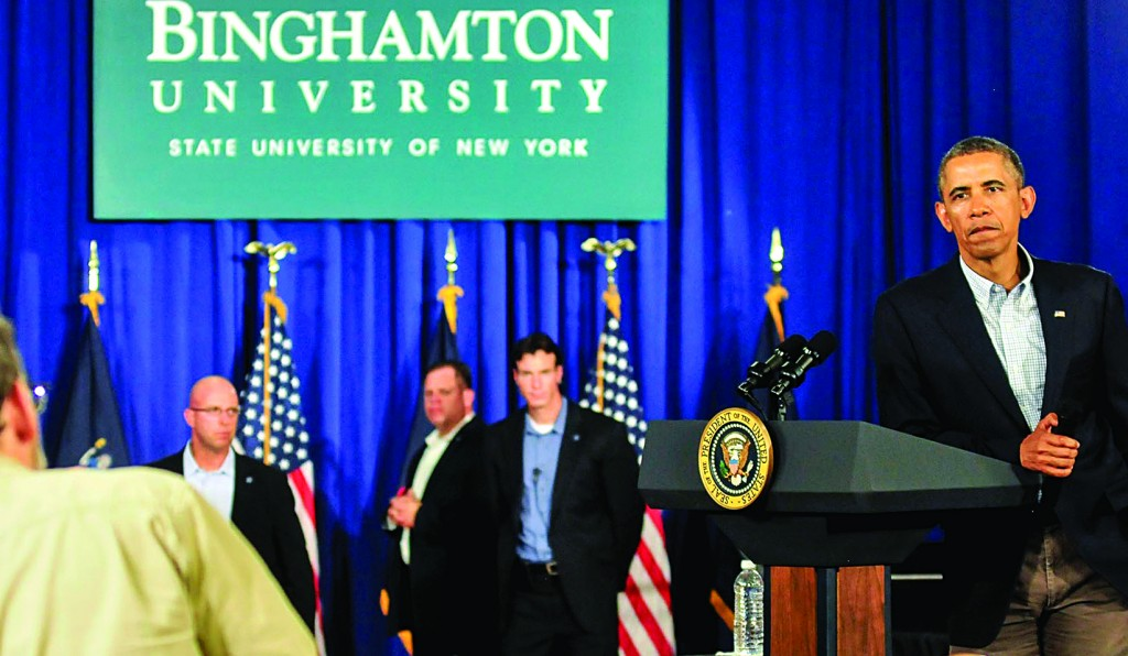 President Obama listens to a question during a town hall meeting at the University Union at Binghamton University on Friday.(AP Photo/Press & Sun-Bulletin, Kristopher Radder)